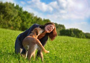 girl and dog playing around